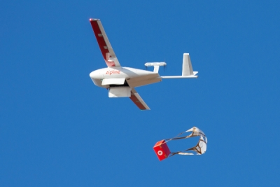 One of Zipline's drones dropping off a delivery.