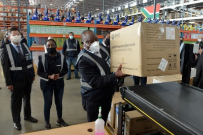 President Ramaphosa at Takedalot warehouse, Kempton Park, receiving PPE shipment. Press Association